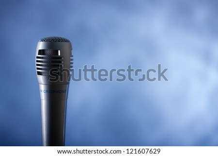 the single microphone on the blue background
