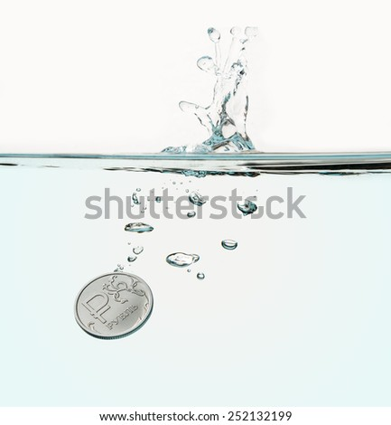 The single Russian ruble coin is being plunged into transparent water with a splash and a string of air bubbles. Financial crisis concept - stock photo