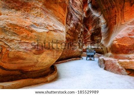 The Siq, a narrow stone gallery in Petra, Jordan - stock photo