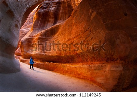 The Siq, the narrow as the entrance passage to the hidden city of Petra, Jordan - stock photo