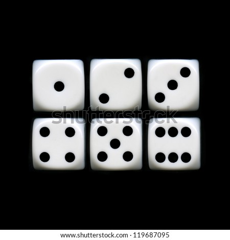 The six sides of a Dice on a black background. - stock photo