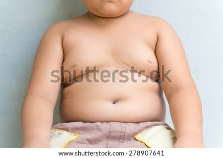 The size of stomach of children with overweight. - stock photo