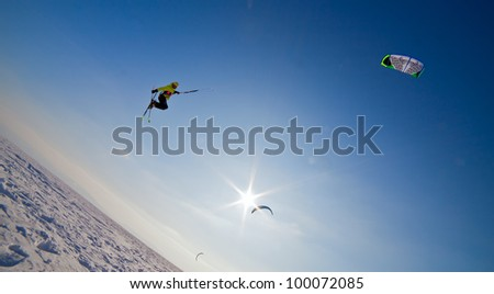 the Ski kiting and jumping on a frozen lake - stock photo