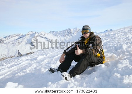 The skier giving thumbs up at snow slope