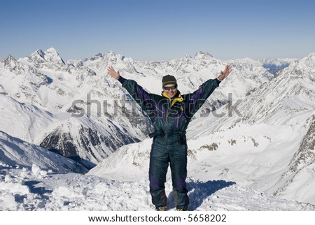 The Skier on a background of mountains - stock photo