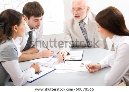 The skilled chief trains the assistants - stock photo