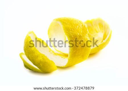 The skin of the peeled lemon isolated on white background - stock photo