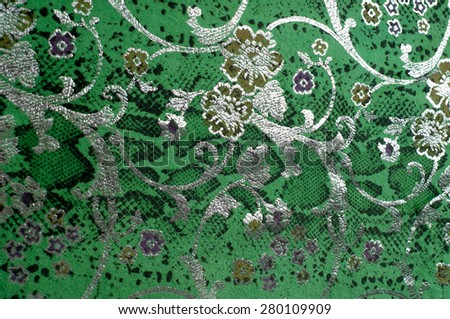 The skin texture, green color patterned. skin texture in light green color.  Close up photo of green color filtered leather surface texture style represent the surface background. - stock photo