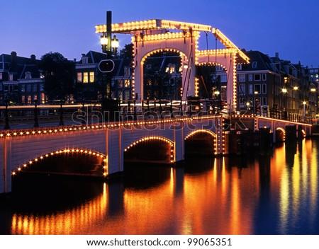The Skinny Bridge (Magere Brug) at night, Amsterdam, Holland, Netherlands, Europe. - stock photo