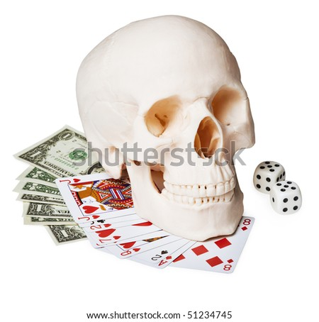The skull on the money and cards, isolated on a white background - stock photo