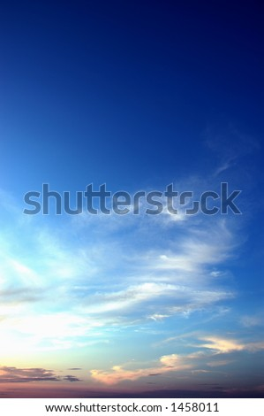 The sky above cities on a sunset. - stock photo