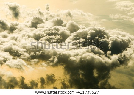 The sky above the beautiful clouds in the warm orange light sunrise background image