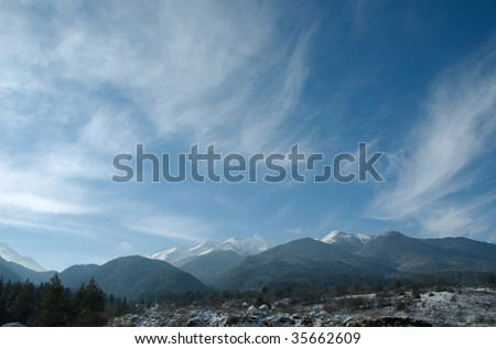 The sky and clouds above mountains.