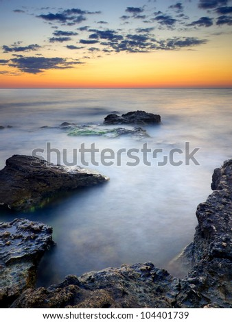 The sky and clouds at sunset. Bright seascape