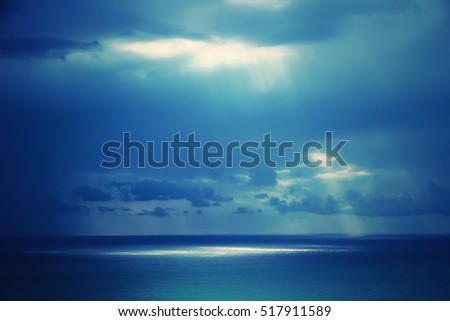 The sky in the clouds, they make their way through the sun's rays and light sea ocean