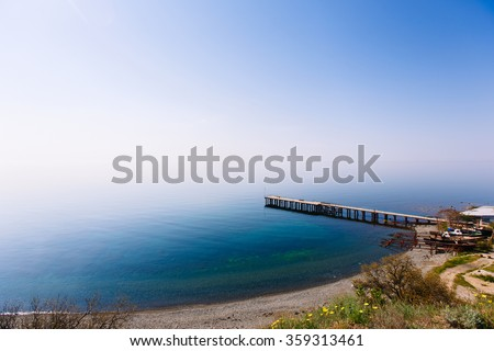 The sky merges with the sea. Black sea merging with the horizon. Tranquil ocean merging with clear beautiful sky at horizon line on sunny warm day - stock photo