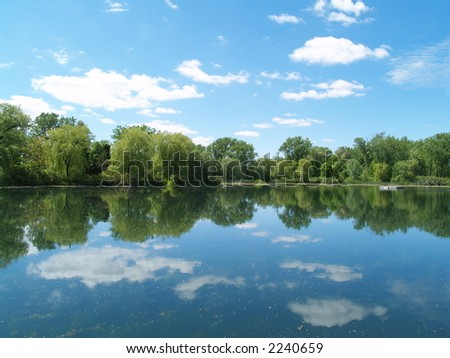 The sky mirroring in the lake - stock photo
