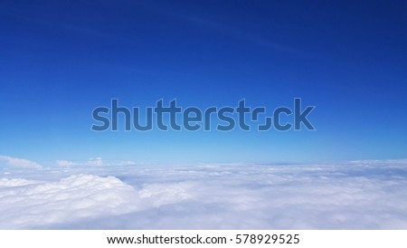 The sky outside the front of the plane