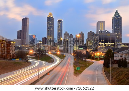 The skyline of Atlanta, Georgia above Freedom Parkway at night. - stock photo