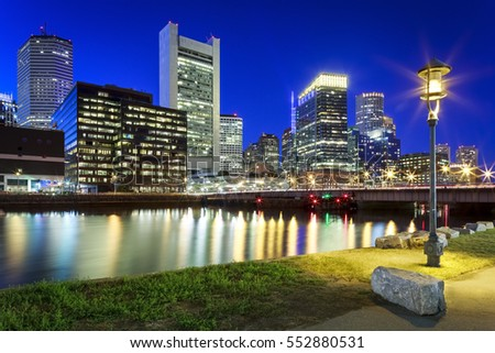 The skyline of Boston in Massachusetts, USA at night by the Boston Harbor at the Financial District.