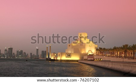 The skyline of Doha, Qatar, and the Museum of Islamic Art at sunset, filtered. - stock photo