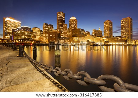 The skyline of downtown Boston, Massachusetts from across the water at dusk. - stock photo