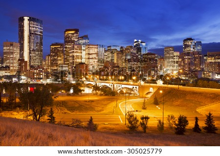 The skyline of downtown Calgary, Alberta, Canada, photographed at dusk. - stock photo