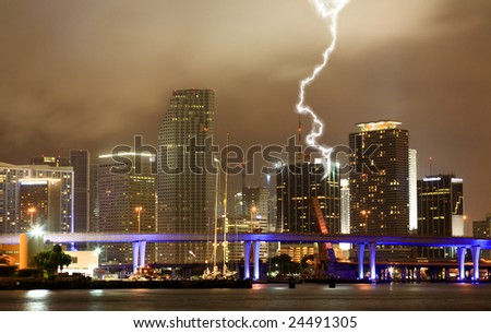The skyline of Miami City at a stormy night - stock photo