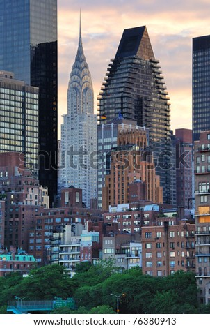The skyline of midtown manhattan at sunset. - stock photo