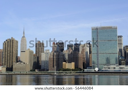 The skyline of midtown Manhattan including the Empire State Building and UN Building - stock photo