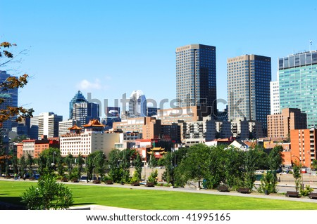 The skyline of Montreal with old harbor park and china town in foreground. - stock photo