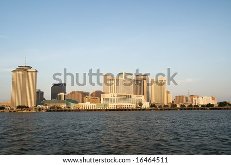 the skyline of New Orleans, Louisiana, just after sunrise - stock photo