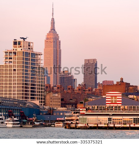 The skyline of New York City at sunset seen from the piers at the Hudson river - stock photo