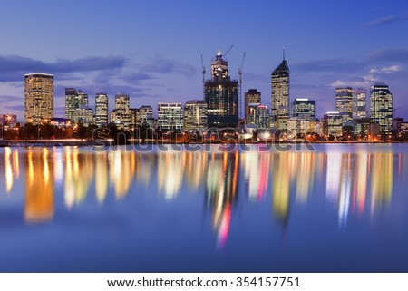 The skyline of Perth, Western Australia at night. Photographed from across the Swan River. - stock photo
