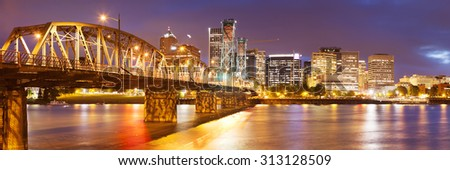 The skyline of Portland, Oregon at night. Photographed from across the Willamette River. - stock photo