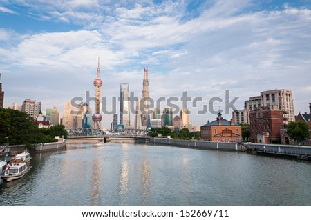 The skyline of Shanghai as seen from across the Huangpu River. - stock photo