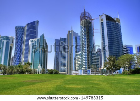 The skyline of the modern and high-rising city of Doha in Katar, Middle East - stock photo
