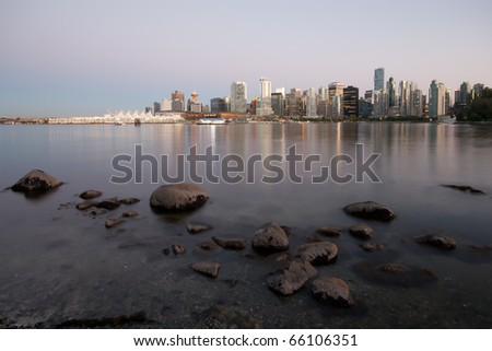 The Skyline of Vancouver viewed from Stanley Park at night - stock photo