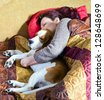 The sleeping woman and its dog - stock photo