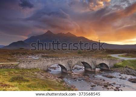 The Sligachan Bridge with The Cuillins in the background on the Isle of Skye, Scotland. Beautiful clouds, photographed at sunset. - stock photo