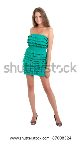 The slim girl in a green dress, isolated