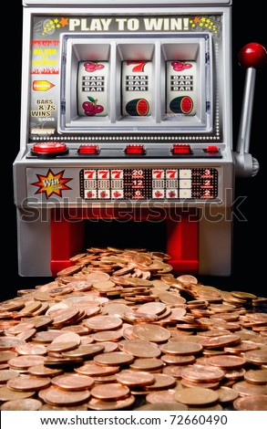 The slot machine spits out a lot of coins - stock photo