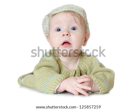 The small baby in a cap isolated, on white background