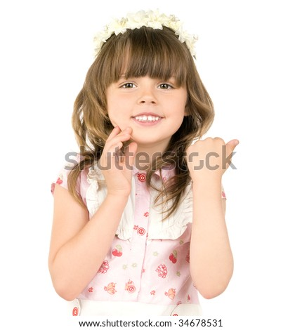 The small beautiful girl smiles, Has bent hands upwards in elbows,  touched fingers  in cheeks, on a white background.