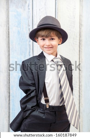 The small boy in office suit - stock photo