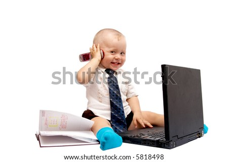 The small boy sits with the computer on a white background - stock photo