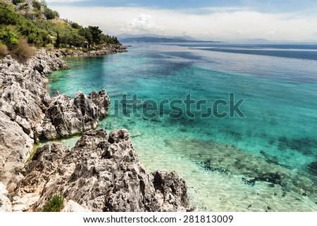 The small but delightful beach at Nissaki on the north-east coast of Corfu island, Greece - stock photo