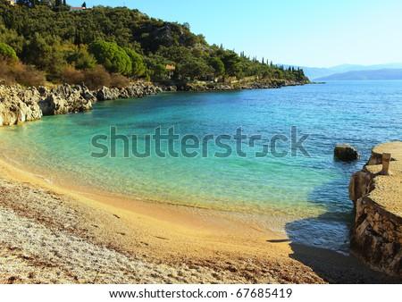 The small but delightful beach at Nissaki on the north-east coast of Corfu island, Greece, - stock photo