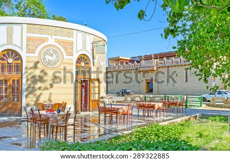 The small cafe in the old Bukhara surrounded by shady trees, making it the best place to relax, Uzbekistan. - stock photo