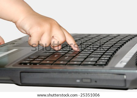 the small child a finger presses the button of a computer
